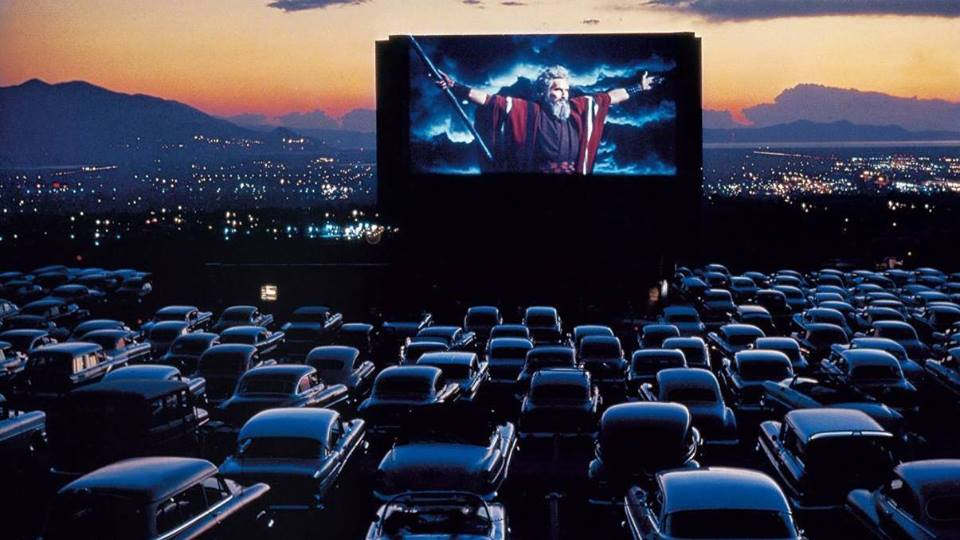 Cars facing a movie screen