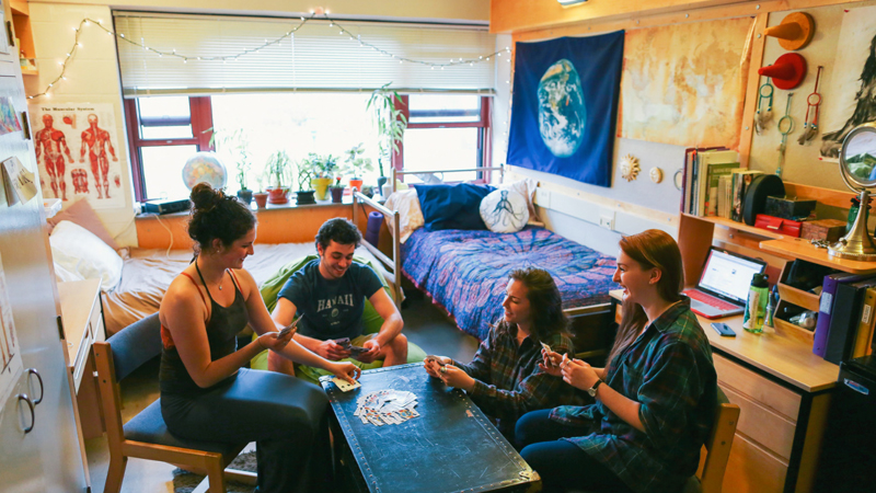 students playing cards in a residence hall room