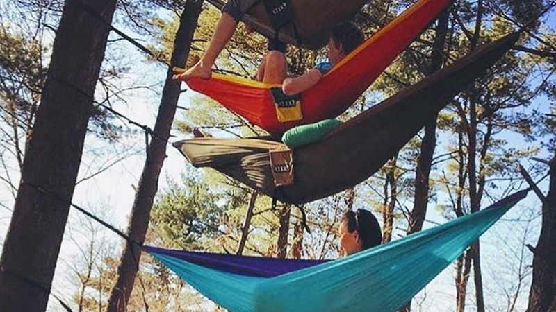 students in stacked in hammocks